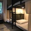 1 bed in a dorm room with 8 bunk beds